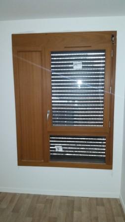Remplacement d'une fenêtre sur rue et d'une porte-fenêtre sur terrasse d'un appartement